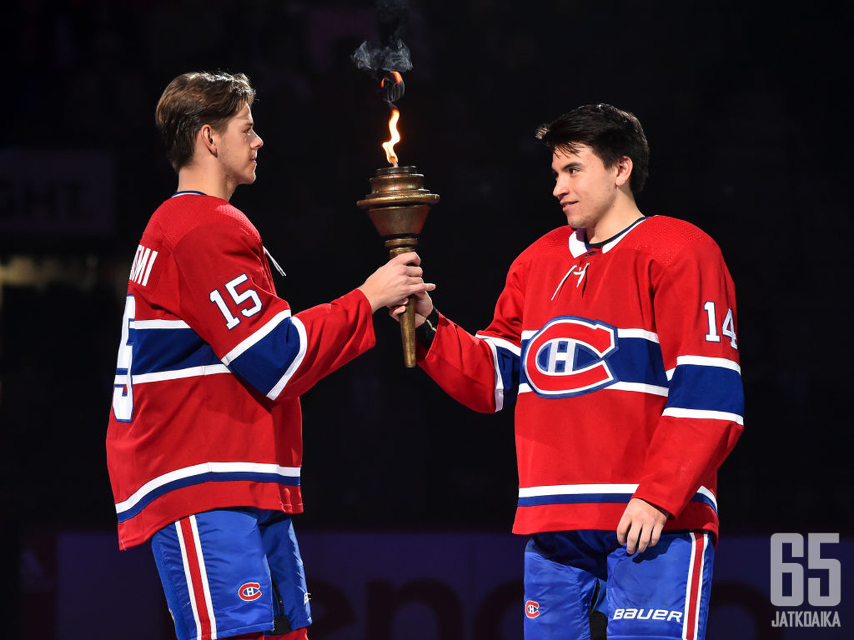 MONTREAL, QC - OCTOBER 10:  Jesperi Kotkaniemi #15 of the Montreal Canadiens (L) and teammate Nick Suzuki #14 (R) take part in the opening ceremony prior to their home game against the Detroit Red Wings at the Bell Centre on October 10, 2019 in Montreal,