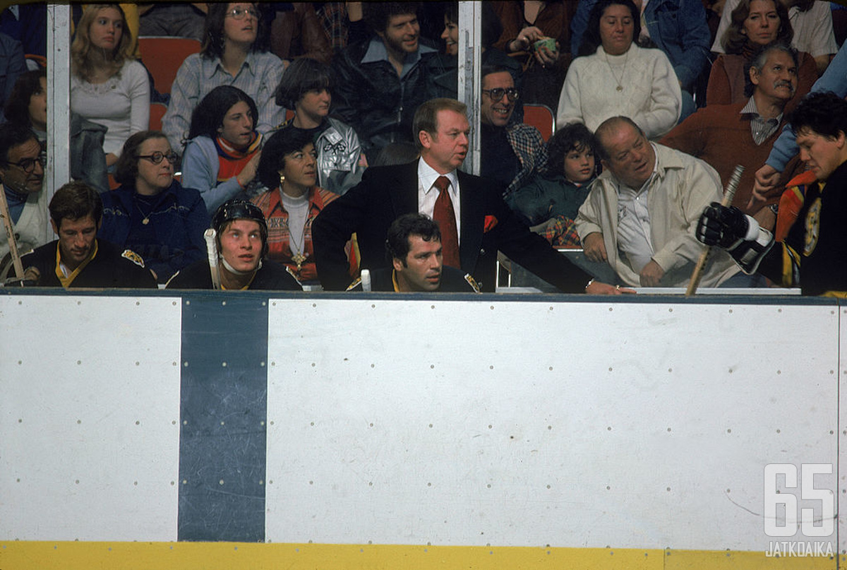 Boston Bruins head coach Don Cherry (in suit) and players behind the bench during an away game, October 1977. (Photo by Bruce Bennett Studios via Getty Images Studios/Getty Images)