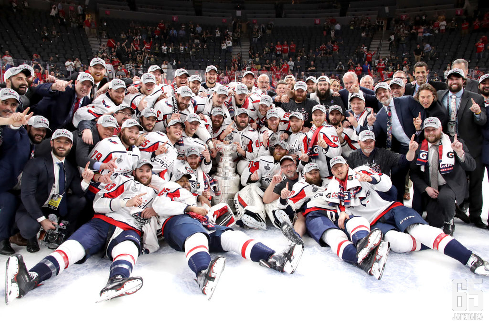 LAS VEGAS, NV - JUNE 07:  The Washington Capitals pose for a photo with the Stanley Cup after their team's 4-3 win over the Vegas Golden Knights in Game Five of the 2018 NHL Stanley Cup Final at T-Mobile Arena on June 7, 2018 in Las Vegas, Nevada.  (Photo