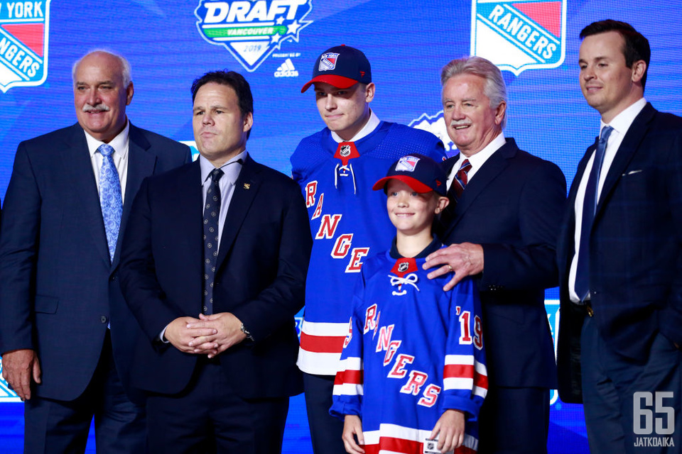 VANCOUVER, BRITISH COLUMBIA - JUNE 21: Kaapo Kakko (third from left), second overall pick by the New York Rangers, poses for a group photo with team personnel during the first round of the 2019 NHL Draft at Rogers Arena on June 21, 2019 in Vancouver, Cana