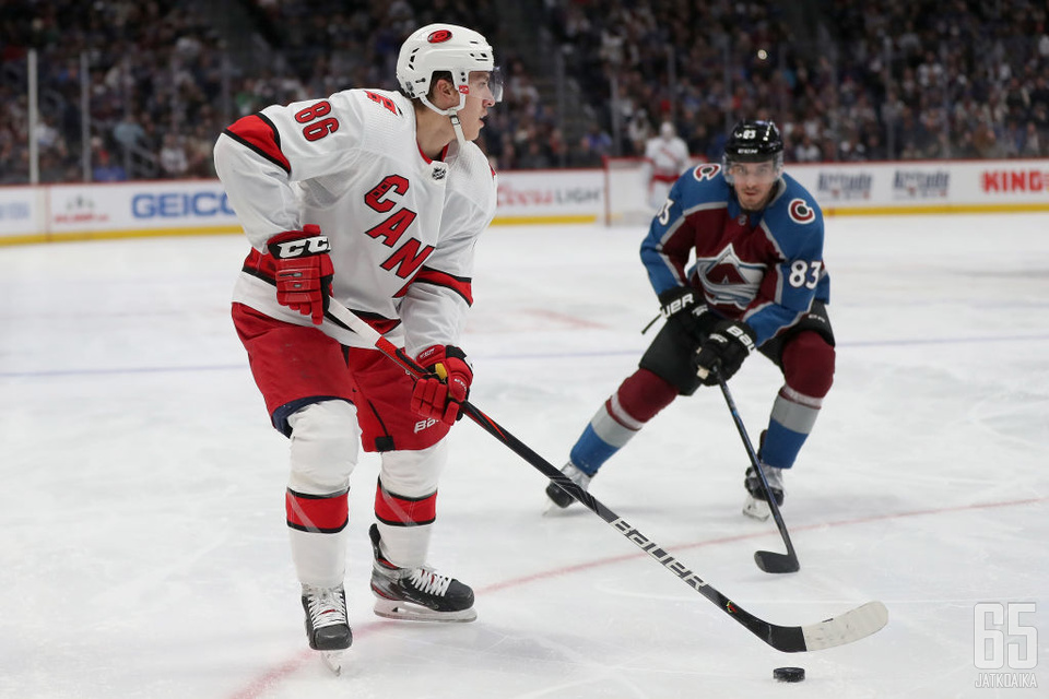 DENVER, COLORADO - DECEMBER 19: Teuvo Teravainen #86 of the Carolina Hurricanes looks for an opening against Matt Nieto #83 of the Colorado Avalanche in the third period at the Pepsi Center on December 19, 2019 in Denver, Colorado. (Photo by Matthew Stock