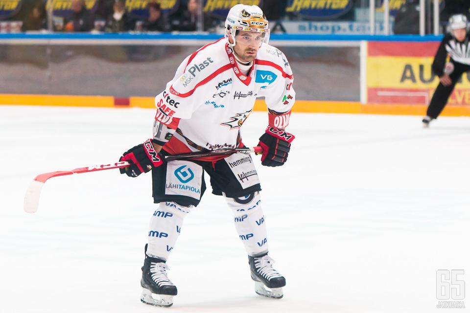 Fleury kiekkoili Sportin paidassa kaudella 2014-15.